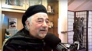 Michael savage at home studio with beret